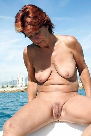 Redhead smoking granny totally naked in the boat