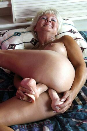 mature women using dildos