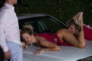 Group foreplay and double penetration on the hood of the car