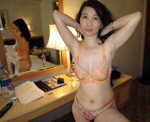 Chinese whores show her hairy bush and saggy tits.