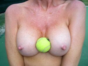 Charming canadian MILF with perfect boobs fully naked at the tennis court